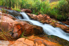 Grand Canyon Cascades. Cascades of a small stream flowing through Grand Canyon National Park on its way to the Colorado River Stock Images