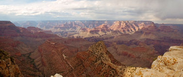 Grand Canyon with cloudy skies panorama Royalty Free Stock Photos