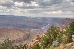 Grand Canyon of Colorado. A view over the Grand Canyon under the clouds royalty free stock photo