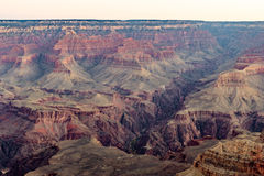 Grand Canyon at Dawn. In the prime of winter, chilled morning, and all sorts of colors climbing up the canyon walls Stock Photos