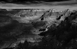 Grand Canyon, Dramatic Monochrome, Sunset. The Arizona sunset illuminates the Grand Canyon as seen from the South Rim. Deep shadows, dazzling highlights, rich Royalty Free Stock Images
