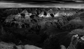 Grand Canyon, Dramatic Monochrome, Sunset. The Arizona sunset illuminates the Grand Canyon as seen from the South Rim. Deep shadows, dazzling highlights, rich Royalty Free Stock Photography
