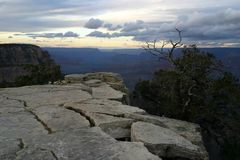 Grand Canyon at dusk. A scenic view of a Grand Canyon ledge at dusk royalty free stock images