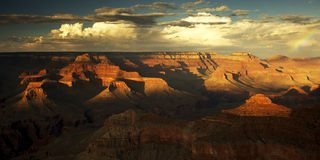 Grand Canyon at dusk. View of the Grand Canyon from the South Rim. The Setting sun has cast long shadows stock photography