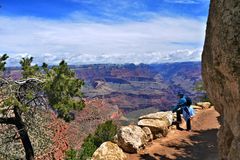Grand Canyon Hiker. A hiker pauses to admire the view from the South Rim of the Grand Canyon stock image