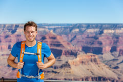 Grand Canyon hiker man portrait with backpack. Bag. Hiking male tourist on Grand Canyon, Arizona, USA. Hiking athlete enjoying view of nature landscape wearing royalty free stock photography