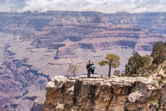 Grand Canyon hiker young couple portrait. Caucasian couple relaxing on South Kaibab Trail, south rim of Grand Canyon, Arizona, USA stock image
