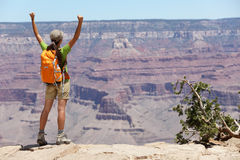 Grand Canyon hiking woman hiker happy and cheerful. With arms raised up outstretched in joy. Winner and success concept with excited elated female hiker Stock Image