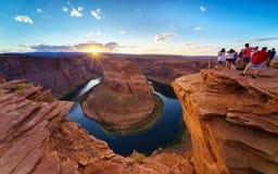 Grand Canyon Horse Shoe Bend shining Sunset Sunstar. Majestic view of Horse Shoe Bend shining sunset Sunstar, Colorado River in Page, Arizona USA Stock Image