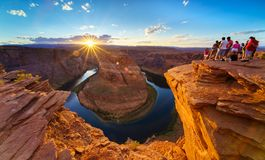 Grand Canyon Horse Shoe Bend shining Sunset Sunstar. Majestic view of Horse Shoe Bend shining sunset Sunstar, Colorado River in Page, Arizona USA Royalty Free Stock Photography