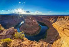 Grand Canyon Horse Shoe Bend shining Sunset Sunstar Royalty Free Stock Images