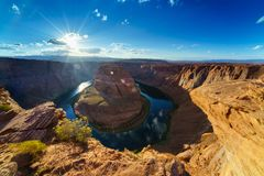 Grand Canyon Horse Shoe Bend shining Sunset Sunstar Royalty Free Stock Photos