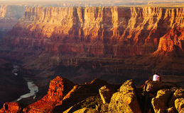 Grand Canyon. Male tourist overlooking the Grand Canyon at sunset royalty free stock photos