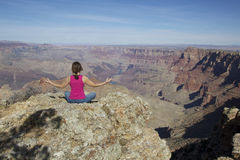 Grand Canyon Meditation. A woman meditates amongst the amazing scenery of the grand canyon Royalty Free Stock Image