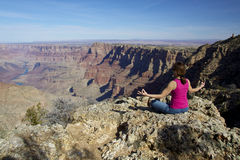 Grand Canyon Meditation. A woman meditates amongst the amazing scenery of the grand canyon Stock Image