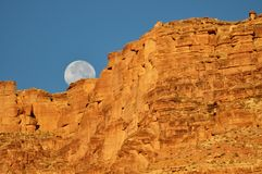 Grand Canyon Moonset. Moon setting behind rim of Grand Canyon Royalty Free Stock Photos