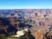 Grand Canyon. National park horizon with one sitting person enjoying the beautiful view, Arizona, USA. Looking from the south rim Royalty Free Stock Image