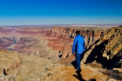 Grand Canyon Nevada hiking man. Man overlooking the vast Grand Canyon in Nevada stock image