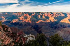 Grand Canyon, South RIM Arizona. Sun rising over the Canyon, creating amazing colors and lights royalty free stock photo