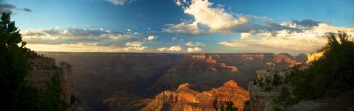 Grand Canyon Panoramic. Pearched at the edge of the south rim of the Grand Canyon, this panorama is composed of 15 images stitched together and just begins to Royalty Free Stock Photos