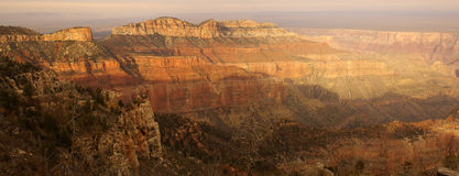 Grand Canyon at Point Imperial. A panoramic view of the Grand Canyon from Point Imperial viewpoint on North Rim lit by setting sun Royalty Free Stock Image