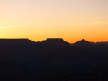 Grand Canyon pre-sunrise. Orange sky over the Grand Canyon just before sunrise royalty free stock photography