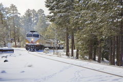 Grand Canyon Railway in Winter. The grand canyon railway train cuts through a winter scene on the way to the canyon stock images