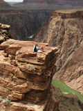 Grand Canyon rest. A woman relaxes at plateau point over the Colorado River, Grand Canyon, Arizona Stock Images