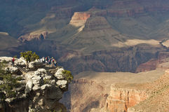 Grand Canyon small group of tourists with giant rock formations Royalty Free Stock Photography