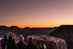 Grand Canyon, South RIM Arizona. Sun rising over the Canyon, creating amazing colors and lights while people enjoy the spectacle stock photos