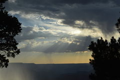 The Grand Canyon South Rim Rain Clouds. The Colorado River carved the Grand Canyon, which is 277 miles long. It was designated as a national park in 1919 and has Royalty Free Stock Photo