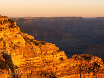 Grand Canyon sunrise 1. Sunrise at the Grand Canyon lighting up the rocks of Hopi Point Stock Photos