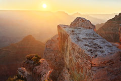 Grand Canyon Sunrise. The rocks of the Grand Canyon (South Rim) at sunrise with the sun just above the horizon royalty free stock photography