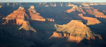 Grand Canyon at sunset. View of Grand Canyon at sunset with red mountain and long shadows - USA Stock Image