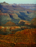 Grand Canyon Sunset, Arizona. The colorful walls of the Grand Canyon, carved by the Colorado River and erosion, become saturated by the golden rays of the Stock Photography