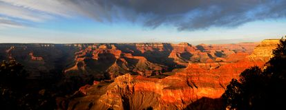 Grand Canyon Sunset Panorama. Orange glow in the Grand Canyon Sunset Royalty Free Stock Images