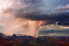 Grand Canyon thunderstorm and lightning. Lightning strikes in the Grand Canyon as a thunderstorm moves through Grand Canyon National Park, Arizona, USA Stock Photos