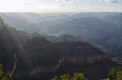 The Grand Canyon. A view over the Grand Canyon with the light rays as the sun sets Stock Photo