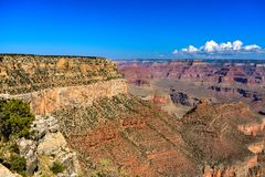 Grand Canyon View. Grand Canyon South Rim in Arizona, USA. Layers of erosion expose red and white colors. Partly cloudy blue sky Royalty Free Stock Image