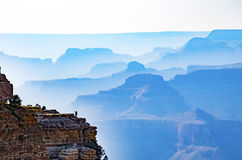 Grand canyon woman selfie. A landscape wide vista view of the grand canyon, with a silhouette of a woman taking a selfie Royalty Free Stock Images