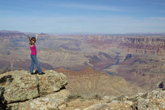 Grand Canyon Wonder. A happy woman raises her arms in wonder and amazemant at the grand canyon Stock Photography