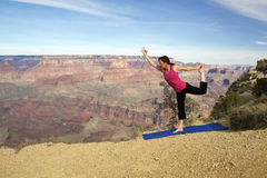 Grand Canyon Yoga Practice. A woman practicing yoga with a backdrop of the grand canyon Stock Photography