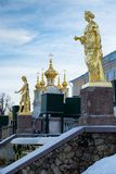 Golden sculptural decoration on the Grand cascade, Fountain in Peterhof, Winter. The Grand cascade is the most grandiose fountain construction of the Peterhof stock images