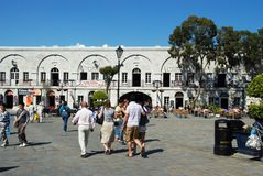 Grand Casemates Square, Gibraltar. Tourists walking through Grand Casemates Square with pavement cafes to the rear, Gibraltar, United Kingdom, Western Europe Royalty Free Stock Image