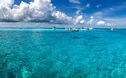 Grand Cayman. Beautiful view on blue transparent water and sky with clouds. Grand Cayman island royalty free stock images
