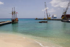 Grand Cayman harbour. Harbour with pirate ship, cranes and cruise ship in the back, George Town, Grand Cayman, Cayman islands royalty free stock image