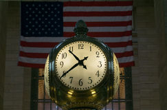 Grand Central Clock Close with Flag Stock Photo