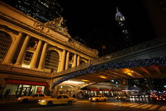 Grand Central Station New York. The Grand Central Terminal/Grand Central Station in Manhattan in New York U.S.A. It is seen at night, with the Chrysler building Royalty Free Stock Images