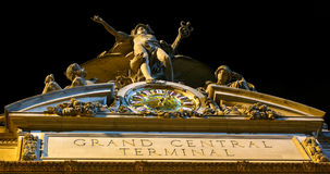 Grand Central Termial, NYC. Close up of the Grand Central Terminal, clock, sign and statues at night in New York City Stock Photos