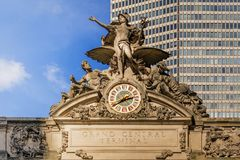 Grand Central Terminal external clock. New York, USA, november 1st, 2016: The iconic beaux arts statue of the Greek God Mercury and the decorated clock adorn the Stock Photo